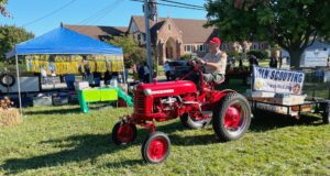 Parade participant on antique tractor.